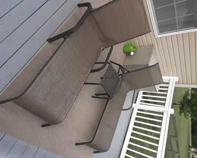 2 patio lounge chairs and table.