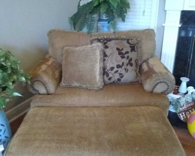Ashley furniture double seat hammered nail chair and ottoman. Elderly mom hardly sat on it. Has been professionally cleaned