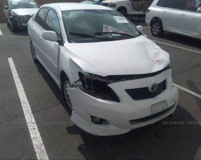 Salvage White 2010 Toyota Corolla