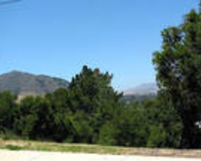 San Luis Obispo 3BR, This 13,430 sq. ft. view lot is located