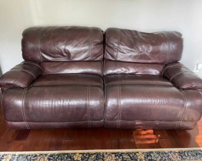 Used leather reclining loveseat and oversized rocking chair