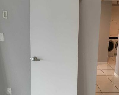 Interior wood door with stainless hardware
