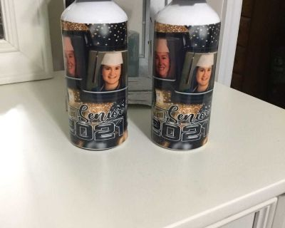Graduation water bottles personalized with photos . These girls have been best friends since they were 5 years old .