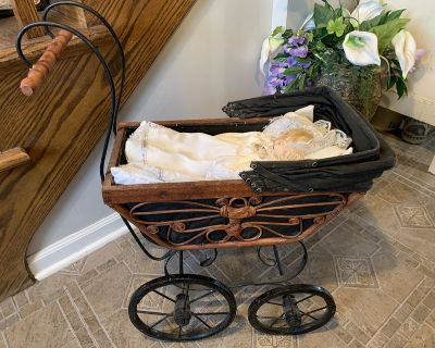 Vintage Baby Doll Pram Carriage Stroller Wicker and Original Canvas Wood Wheels with a baby and ...