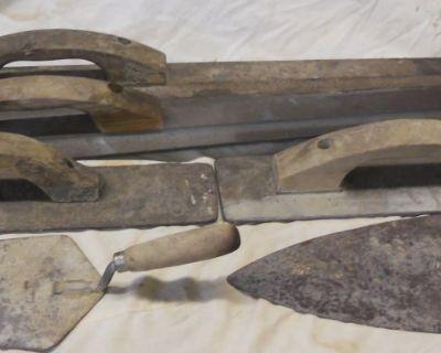 Concrete finishing tools