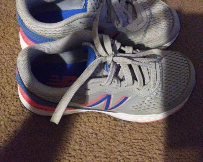 Girl's New Balance tennis shoes size 13. Worn once.