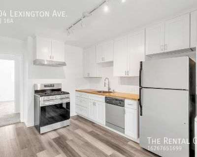 Updated Top Floor Unit In Triplex | Communal Front Patio | Storage Garage | One Driveway Parking Space Included!