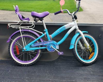 Girls small bike with doll seat