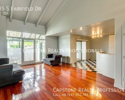 Gorgeous light and bright 2 bedroom town home is appointed with beautiful wood, tile and carpet flooring