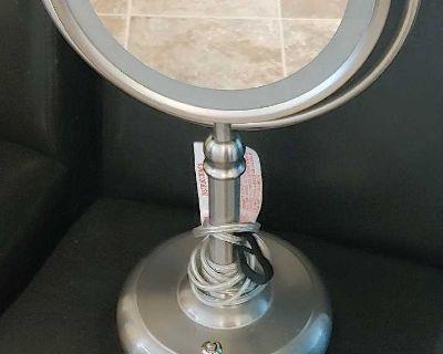 Dual sided light up makeup mirror