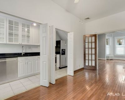 2 Bed, 1 bath, Exposed Brick Interior with back patio! - 15 minute walk from Capitol Hill!