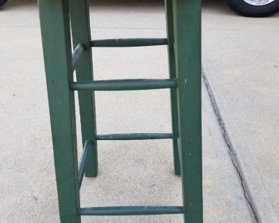 24 inches tall. Wood stool.