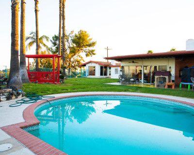 Huge Backyard with Pool, Bridge, Waterfall, Koi Fish pond, and a 1970s vibe., Los Angeles, CA