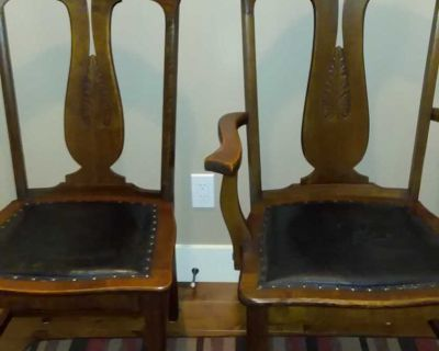 2 Antique dining chairs , one is a captain's chair