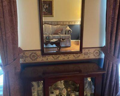 Curio cabinet with mirror