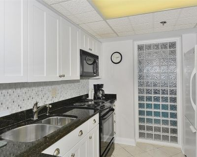 DAILY ACTIVITIES & LINENS INCLUDED*! Direct Oceanfront 2 bedroom (enclosed den converted to a third bedroom with new double bed & pocket door) 2 bath condo. - North Ocean City