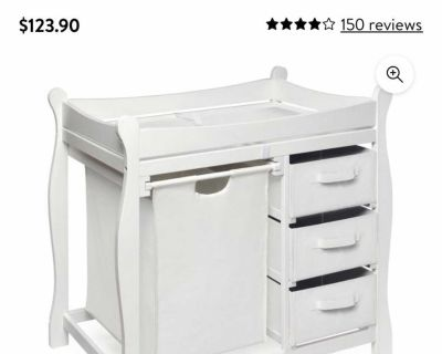 Changing table with baskets and pad