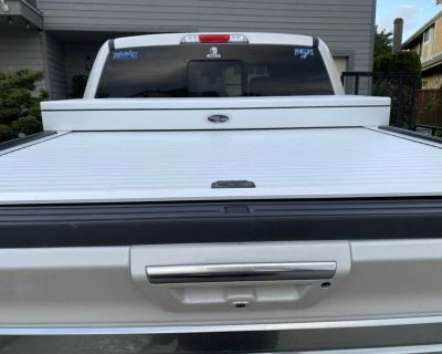 Hard roll truck cover with tool box