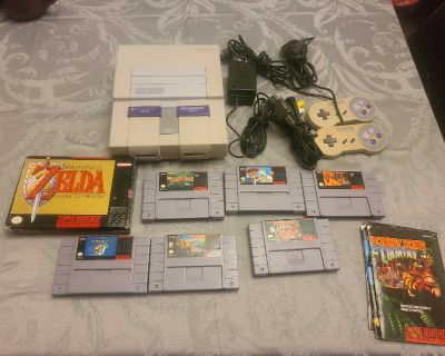 Super nintendo with 7 games