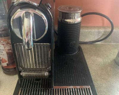 Nespresso coffee maker with milk frothier and a reusable coffee pod FCFS