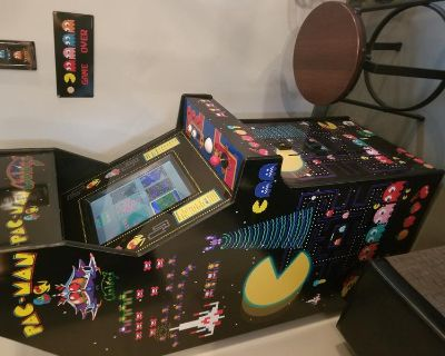 Classic Pacman arcade machine with 60 all-time favorite games