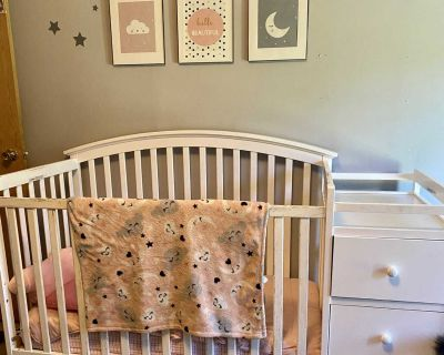 White crib w/ attached changing table