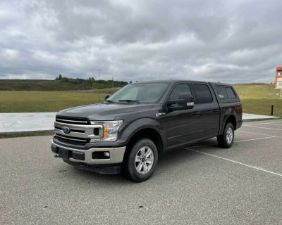2018 Ford F-150 XLT truck with topper
