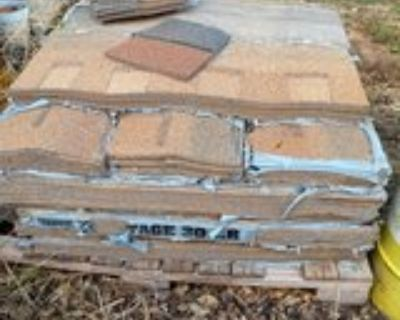 Pallet of roofing shingles