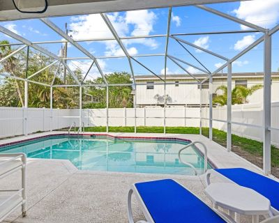 Welcome to 5537 Palmetto Street, a private home with 3 bedrooms and 3 baths and a private heated swimming pool - Mid Island