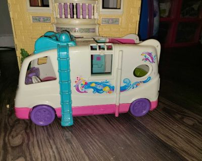 Fisher price doll house and vacation camper