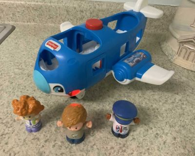 Little People Travel Together Airplane it says several phrases with lights and sounds , songs & music