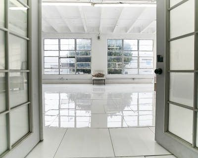 Daylight photo studio with white tile gloss floor, creme flower corner, framed windows, wooden queen bed, white baldachin - Hill 1, Los Angeles, CA