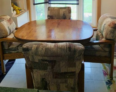Oak table with leaf and 1 Drawer at each end and 4 comfortable material chairs set