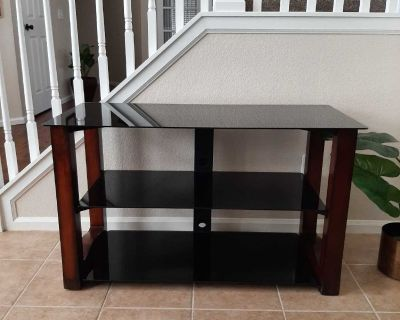 TV Stand-Brown legs and Black tempered glass shelves
