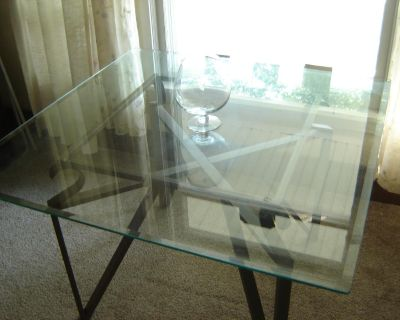 TABLE with beautiful glass top w/ beveled edges. excellent condition. $200.