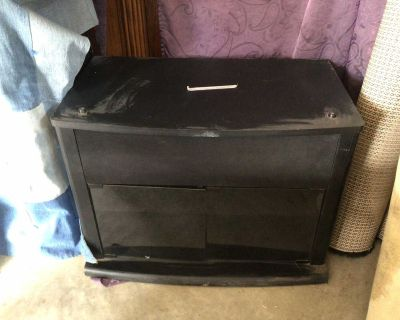 Black TV stand with glass doors and two shelves in great shape just a little dusty from being in the garage