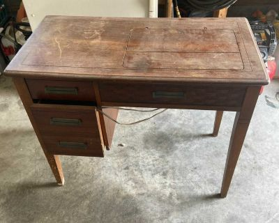 In table sewing machine