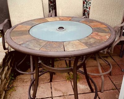 Patio Table And Four Hightop Swivel Chairs