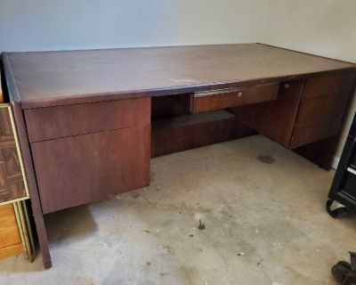 Very Heavy Wooden Office Desk in a dark brown finish with 2 drawers on the left side;1-center;3-storage. Located in Johns Creek-30097
