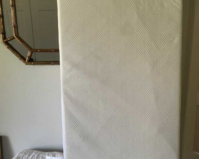 Crib mattress with fitted zippered cover plus two extra mattress protectors