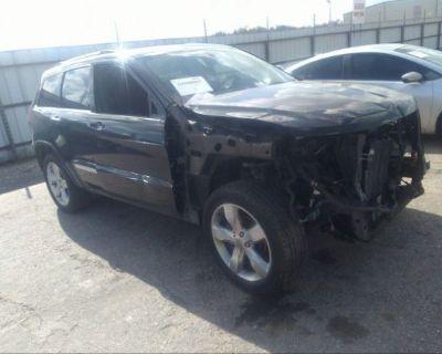 Salvage Black 2012 Jeep Grand Cherokee