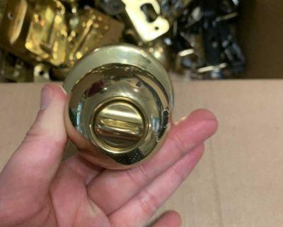 Set of round gold door handles