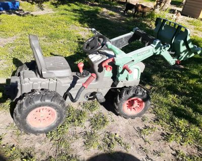 Well loved pedal tractor