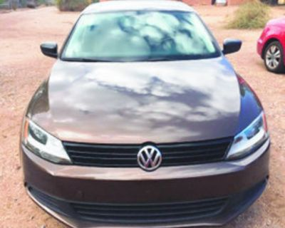 Volkswagen 2013 Jetta 67,000 miles, automatic transmission, brown with gray interior....