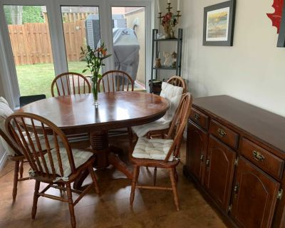Antique dining room composed of table, buffet and 6 chairs and cushions
