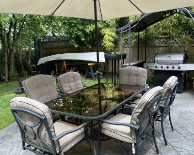 Glass patio table with 6 chairs and umbrella