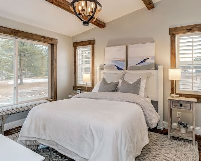 Cottage on a hill overlooks ponderosa pines, and the majestic front range. - Black Forest
