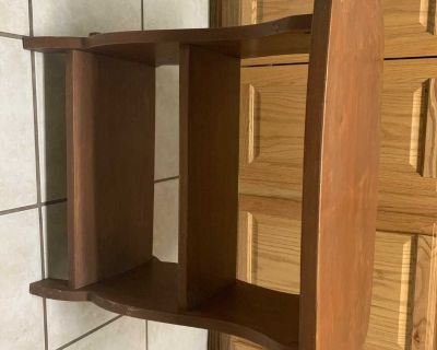 Wooden table with shelves
