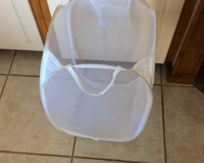 SMALL LAUNDRY CARRIER. ( HAS TWO HANDLES FOR CARRYing )