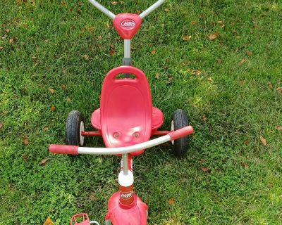 Radio flyer trike with handle. Has pneumatic tires.